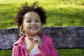 Young black baby girl with glasses smiling — Stock Photo