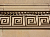 Intricate mouldings on old sandstone building — Stock Photo
