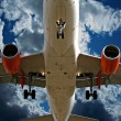 Close up of passenger plane landing overhead — Stock Photo
