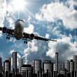 Passenger jet set against cityscape illustration — Stock Photo