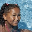 Young black girl in swimming pool - Stock Photo