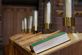 Bible on wooden bench in church — Stock Photo