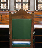 Looking into courtroom from behind judges chair — Stock Photo