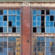 Stock Photo: Broken windows on old derelict building