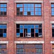 Broken windows on old derelict building — Stock Photo