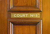 Oak door leading into court — Stock Photo