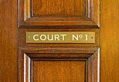 Oak door leading into court — Stock Photo