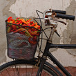 Old rusty bicycle with colorful peppers in basket — Стоковая фотография
