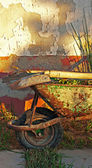 Gardening tools in old rusty wheelbarrow — Стоковое фото