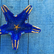 Dark blue starfish on blue decking background — Stock Photo