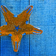 Yellow starfish on blue decking background — Stock Photo