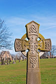 A Cross in ancient graveyard — Stock Photo