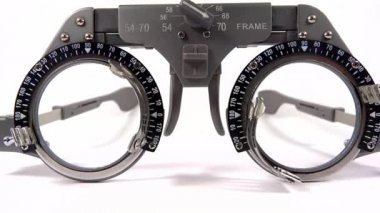 Spectacles used for eyesight tests with various lenses and occlusion on white background — Stock Video
