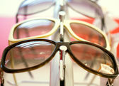 Sunglasses.close up shades and sunglasses in optician's shop — Stock Photo