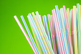 Colored Drinking Straws On Green Background — Stock Photo