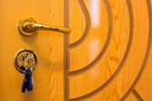Keys is inserted into a keyhole — Stock Photo