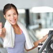 Happy fitness woman thumbs up in gym — Stock Photo #22277915