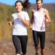 Young couple running — Stock Photo #22278119