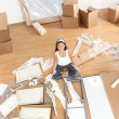Royalty-Free Stock Photo: Moving woman in new home