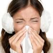 Flu or cold sneezing woman - Stock Photo