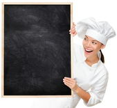 Chef showing blank menu sign — Stock Photo