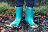 Fall, Autumn concept - Rain boots in mud puddle — Stok fotoğraf