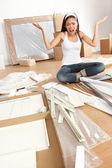 Woman moving in - furniture assembly frustration — Stock Photo