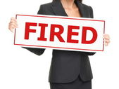 Unemployment - woman holding Fired sign on white — Stock Photo