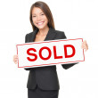 Realtor or Real estate agent woman sold sign on white background — Stock Photo