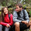 Young couple hiking - Stock Photo