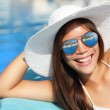 Summer girl smiling by pool - Stock Photo