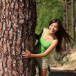 Woman playful in forest — Stock Photo