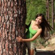 Woman playful in forest — Stock Photo #22311155