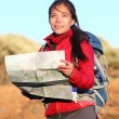 Hiking woman in nature holding map — Stock Photo