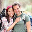 Happy young couple hiking — Stock Photo