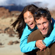 Happy young couple smiling outdoors — Stockfoto