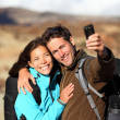 Happy young couple outdoors hiking — Stock Photo #22312203