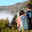 Stock Photo: Couple hiking looking at view