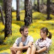 Happy couple in forest — Stockfoto