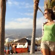 Beach boardwalk woman enjoying the sun in Tenerife - Stock Photo
