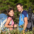 Happy hiking couple smiling - Stok fotoğraf