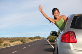 Woman in car road trip — Stock Photo