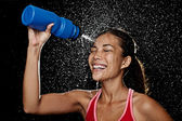 Fitness runner woman drinking — Stock Photo