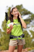 Sunscreen woman hiking applying sun lotion — Stock Photo