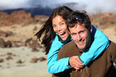 Happy young couple smiling outdoors — Stock Photo