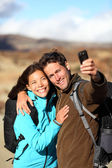 Happy young couple outdoors hiking — Stock Photo