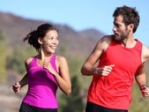 Happy couple running — Stock Photo