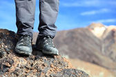 Hiking shoes in mountain nature landscape — Stock Photo