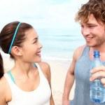 Fitness couple on beach — Stock Photo