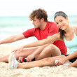 Stock Photo: Couple training on beach